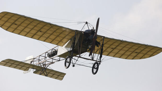 French pilot Edmond Salis flies a replica of the original Bleriot XI, ending his flight after crossing the English Channel
