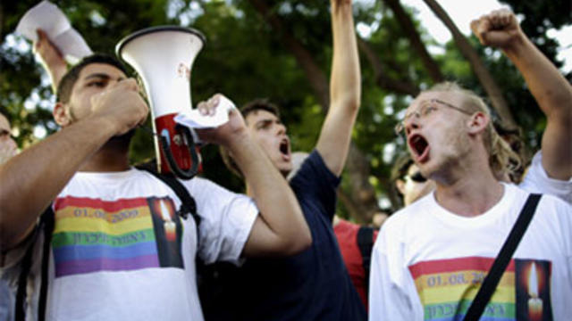 Members of the gay community protest near the sit of a shooting attack in Tel Aviv, Israel, Sunday, Aug. 2, 2009.