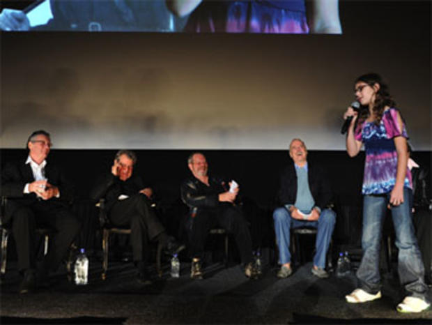 "Michael Palin, Terry Jones, Terry Gilliam, John Cleese and Eric Idle with 10-year-old Talia Lindner who performed the Monty Python ""Spanish Inquisition"" sketch on stage during the Q&A portion of the Monty Python 40th anniversary reunion, at New York's Zie"
