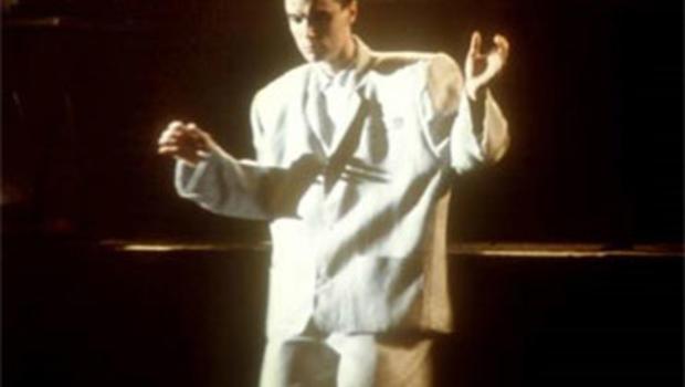 "David Byrne of Talking Heads in the concert film ""Stop Making Sense."""