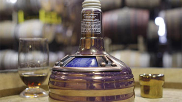 A bottle of Boston Beer Company's Utopias, which costs $150, is displayed in the barrel room at the company in Boston. The beer, which is 27 percent alcohol by volume, has been compared to fine cognac and sherry.