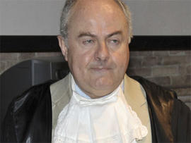 Prosecutor Giuliano Mignini gestures during a hearing in the Meredith Kercher murder trial, in Perugia, Italy, Friday, June 12, 2009.