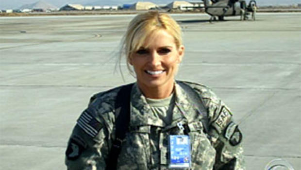 """U.S. Lt. Col. Vanessa Benson is seen in the Saturday, Dec. 12, 2009, broadcast of the """"CBS Evening News."""" She is battling for custody of her 14-year-old son John after temporarily giving her ex-husband custody before she was deployed in December 2008."""