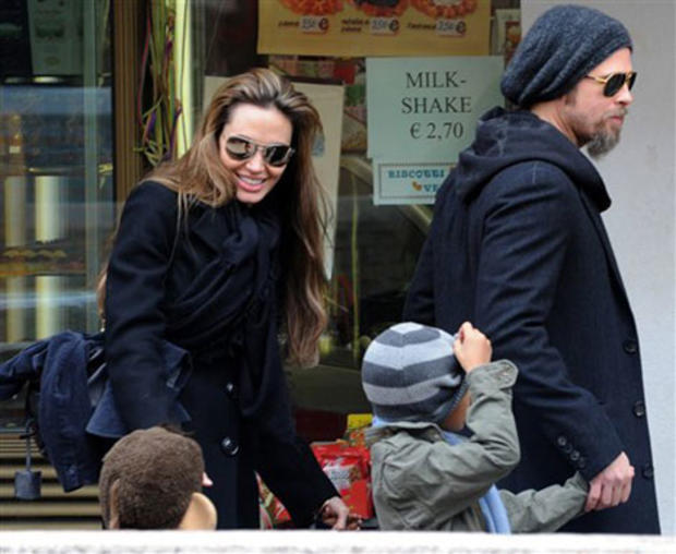 Actors Angelina Jolie, left, and Brad Pitt, second left, are seen with children Maddox, left, Shiloh Nouvel, in Venice, Tuesday, Feb. 16, 2010.  (AP Photo/Luigi Costantini)