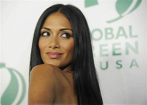 Nicole Scherzinger of the Pussycat Dolls poses at Global Green USA's 7th Annual Pre-Oscar Party in Los Angeles, March 3, 2010. (AP Photo/Chris Pizzello)