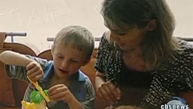 Russian authorities say a 7-year-old boy named Artyom arrived all alone in Moscow after an overnight flight from Washington, D.C. - with a letter from his adoptive American mother.