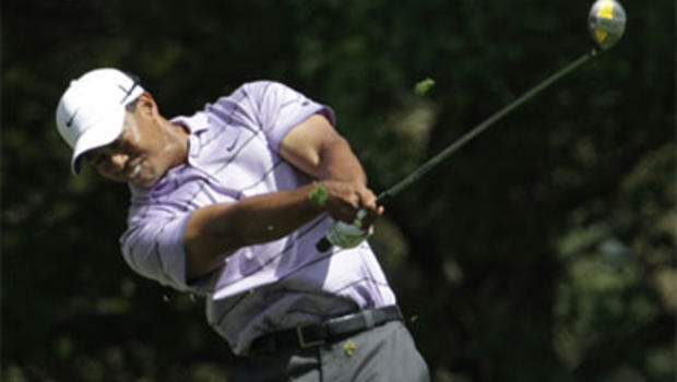 Tiger Woods tees off at the fourth hole during the third round of the Masters golf tournament in Augusta, Ga., Saturday, April 10, 2010.