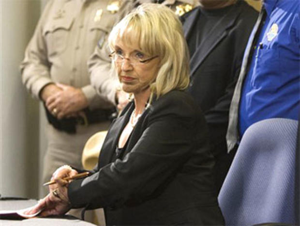 Gov. Jan Brewer signs bill SB1070 dealing with illegal immigration during a news conference at the Arizona Department of Transportation in Phoenix on Friday, April 23, 2010. (AP Photo/The Arizona Republic, Tom Tingle)