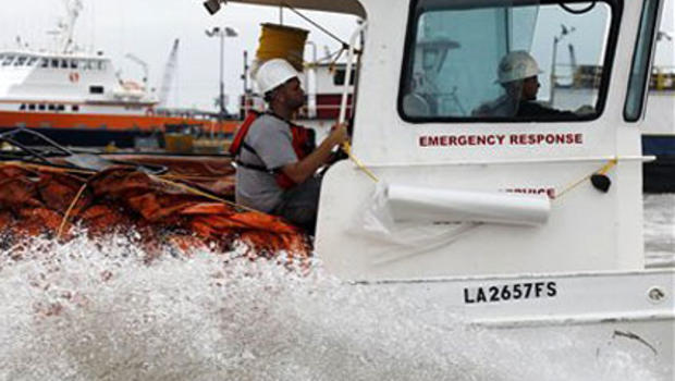 An emergency response boat is loaded with protective boom as they head out from Venice, La., Tuesday, May 4, 2010. Cleanup and containment of a massive oil slick resumed Tuesday as winds eased in the Gulf of Mexico and people along beaches and bayous wait