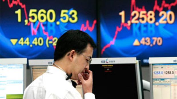 Global Stocks Tank As Euro's Slide Continues - CBS News