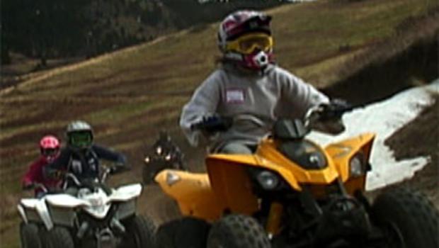 Unidentified children ride ATVs.
