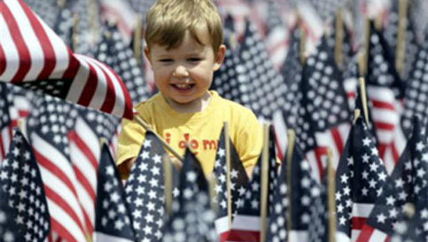 Cameron Geiselman, 2, of Springfield, Va., plays in a sea of flags on the National Mall in Washington, Wednesday, June 30, 2010, placed by The Sierra Club, veterans, unions, and conservationist to call for freedom from oil. (AP Photo/Carolyn Kaster)   gen