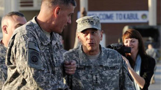 In this July 2, 2010 photo released by the U.S. Air Force, newly appointed International Security Assistance Forces Commander, Gen. David Petraeus, center right, greets Lt. Gen. David Rodriguez upon his arrival in Kabul, Afghanistan to take command of U.S