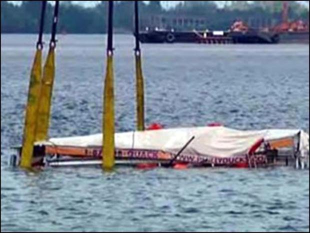 The sunken duck boat is retrieved from the bottom of the Delaware River, Philadelphia, July 9, 2010.