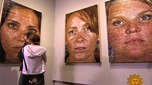 Using just five colors of push pins – red, yellow, blue, white and black – Eric Daigh creates portraits that create the illusion of skin tone and hair.