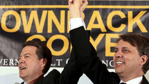 Kansas Republican Gubernatorial candidate Sen. Sam Brownback, left, and Lt. Gov. candidate Jeff Colyer acknowledge the crowd at a Johnson County election watch party Tuesday, Aug. 3, 2010 in Overland Park, Kan. (AP Photo/Charlie Riedel)