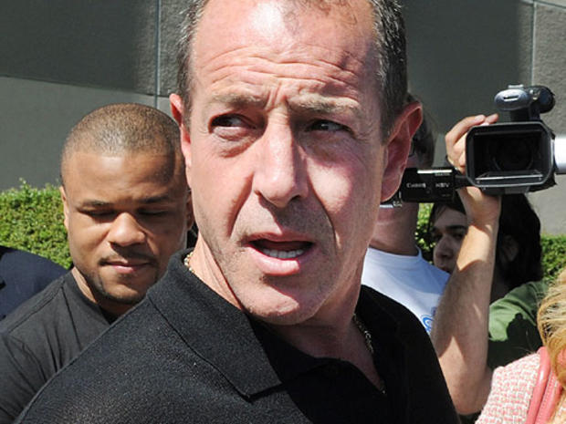 Michael Lohan, the father of Lindsay Lohan, leaves the building after she was sentenced to 90 days jail by Judge Marsha Revel during her hearing at the Beverly Hills Courthouse on July 6, 2010.