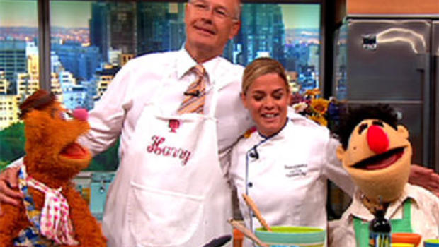 """From left, Fozzie Bear, Harry Smith, Cat Cora and Angelo on """"The Early Show."""""""