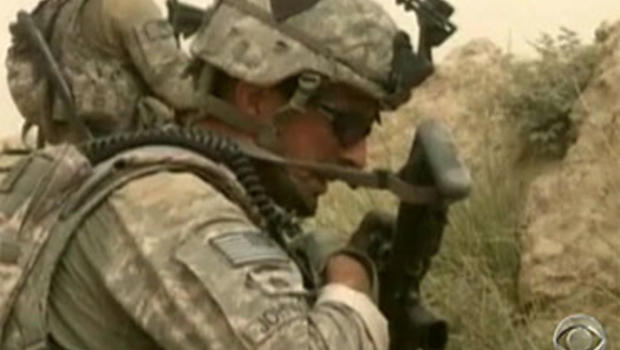 Army Staff Sgt. Adam Johnson communicates on a radio during a firefight in southern Afghanistan.
