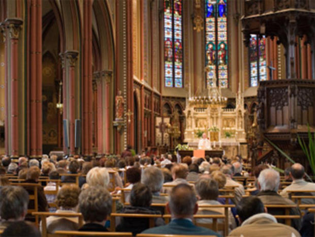 Full church, with Roman Catholic service.
