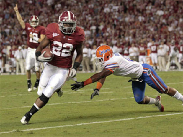 Alabama's Mark Ingram (22) carries on a first-quarter touchdown as Florida's Jeremy Brown (8) defends in an NCAA college football game at Bryant-Denny Stadium in Tuscaloosa, Ala., Saturday, Oct. 2, 2010.