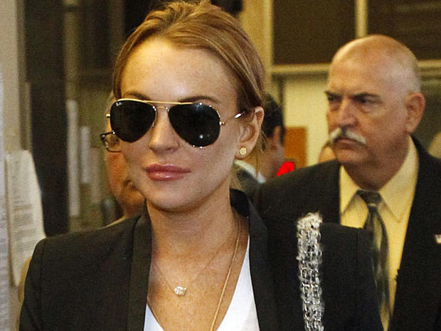 Lindsay Lohan leaves the Beverly Hills courthouse after attending a probation violation hearing for failing a drug test on Oct. 22, 2010, in Beverly Hills, Calif.