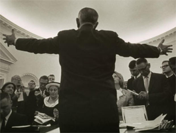 Lyndon B. Johnson's photographer Yoichi Okamoto disappeared behind the President to make this image in the Oval Office.