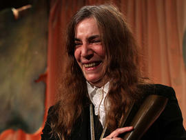 "Patty Smith, winner of the National Book Award for Nonfiction for her book ""Just Kids"", poses with her award at the National Book Awards Wednesday Nov. 17, 2010 in New York. (AP Photo/Tina Fineberg)   --------------------------------------------------------------------------------"
