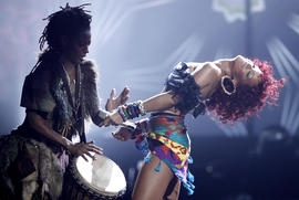 Rihanna, right, performs at the 38th Annual American Music Awards on Sunday, Nov. 21, 2010 in Los Angeles. (AP Photo/Matt Sayles