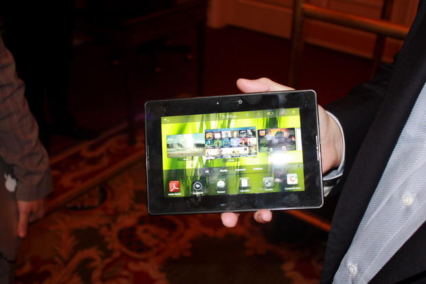 Research in Motion co-CEO Mike Lazaridis shows off the Playbook tablet on the sidelines of the D: Dive Into Mobile conference.