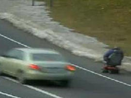 On A Roll? Intrepid Wheelchair User Cruises On Side Of Conn. Highway