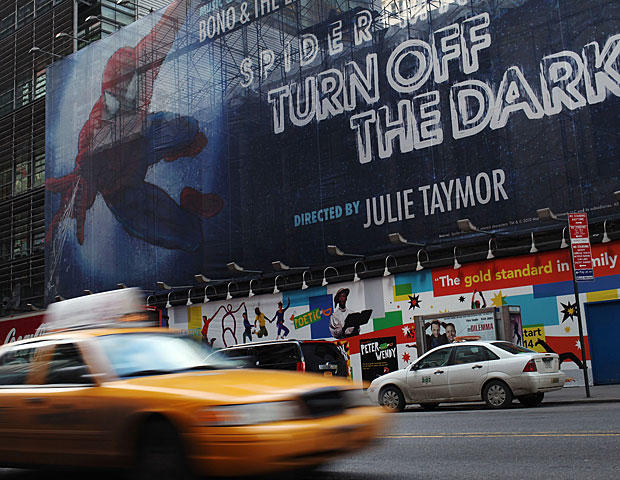 A sign for the Broadway play 'Spider-Man: Turn off the Dark' is seen along 42nd Street on Feb. 8, 2011 in New York City.(Photo by Spencer Platt/Getty Images