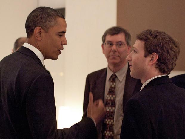 President Barack Obama talks with Facebook founder and CEO Mark Zuckerberg