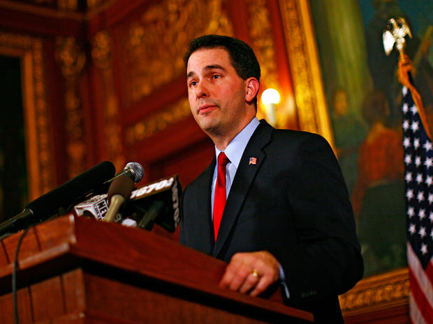 Republican Gov. Scott Walker speaks at a news conference inside the Wisconsin State Capitol