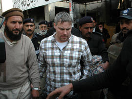 Pakistani security officials escort Raymond Allen Davis