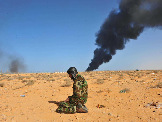 Government troops drove opposition forces out of the strategic oil town Ras Lanuf, Libya.