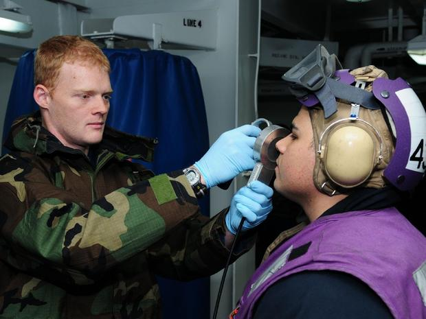 Navy personnel check for radiation levels in operations off the coast of Japan, March 18, 2011.