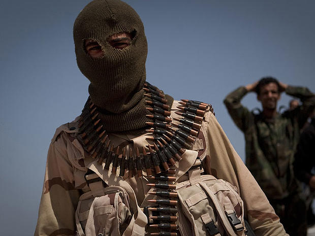 A Libyan rebel on the front line outside of Bin Jawaad, 150 km east of Sirte, central Libya, Monday, March 28 2011.