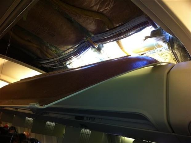 In this photo provided by passenger Christine Ziegler, shows an apparent hole in the cabin on a Southwest Airlines aircraft Friday, April 1, 2011 in Yuma, Ariz. Authorities say the flight from Phoenix to Sacramento, Calif., was diverted to Yuma due to rap