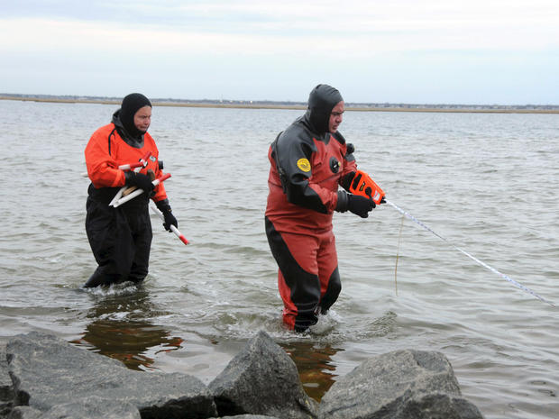 Suffolk County Polive take measurements for a search grid.