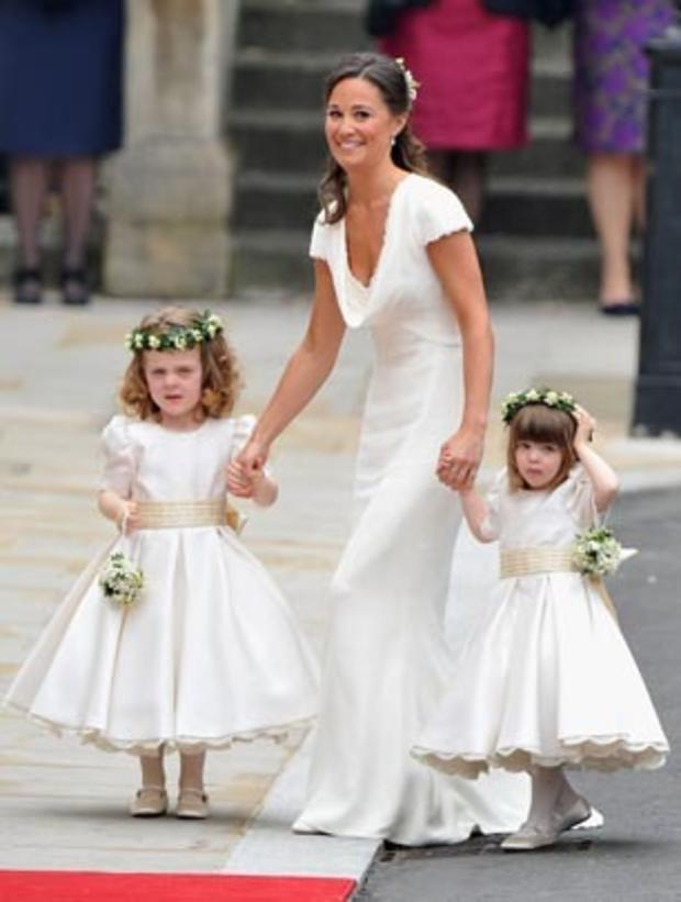 Philippa Middleton, sister of Kate Middleton and Maid of honour, arrives with the bridesmaids at the West Door of Westminster Abbey in London for the wedding of Britain's Prince William and Kate Middleton, on April 29, 2011. AFP PHOTO / PAUL ROGERS / POOL