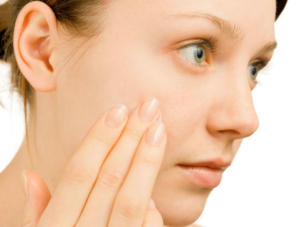 woman-examining-face.jpg
