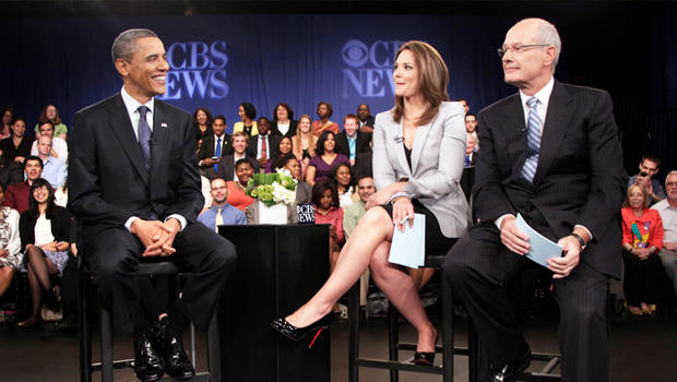 """President Barack Obama visits with CBS News correspondent Harry Smith and """"Early Show"""" co-anchor Erica Hill. during a break at a CBS News Town Hall Meeting on the economy at the Newseum in Washington, Wednesday, May 11, 2011. (AP Photo/Carolyn Kaster)"""
