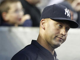 New York Yankees' Derek Jeter watches during the second inning of a baseball game against the Texas Rangers on June 14, 2011, at Yankee Stadium in New York.