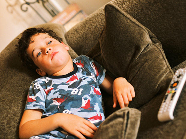 kid, boy, youth, couch potato, watching tv, lazy, bored, sloth, stock, 4x3