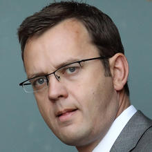 Director of Government Communications Andy Coulson, a former News of The World editor, leaves his house Sept. 9, 2010, in London. Photo credit: Getty Images