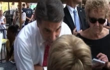 Perry heckled in New Hampshire, asked about evolution
