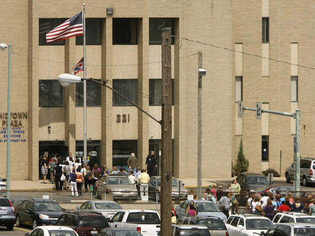 People evacuate the Midtown Plaza Stark County Jobs & Family Services building in Canton, Ohio, after feeling an earthquake  Aug. 23, 2011.