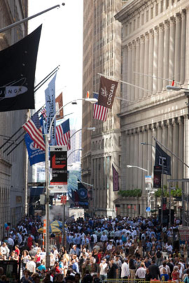 Crowds stand on Wall Street after a 5.9 earthquake struck on Aug. 23, 2011, in New York.