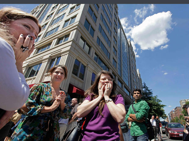 Office workers gather on the sidewalk in downtown Washington, Tuesday, Aug. 23, 2011, moments after a 5.9 magnitude tremor shook the nation's capitol.